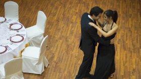 A couple dance in a ballroom